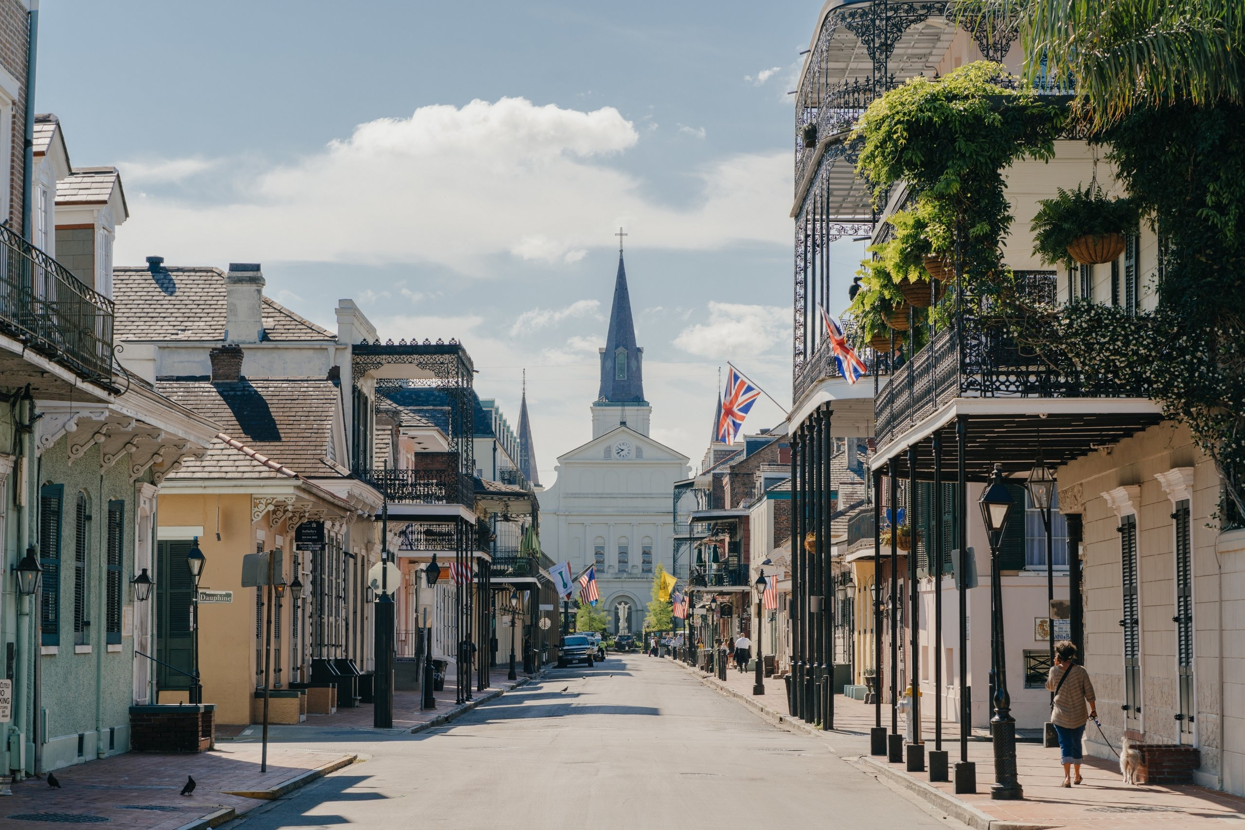A New Orleans street that runs down toward a cathedral