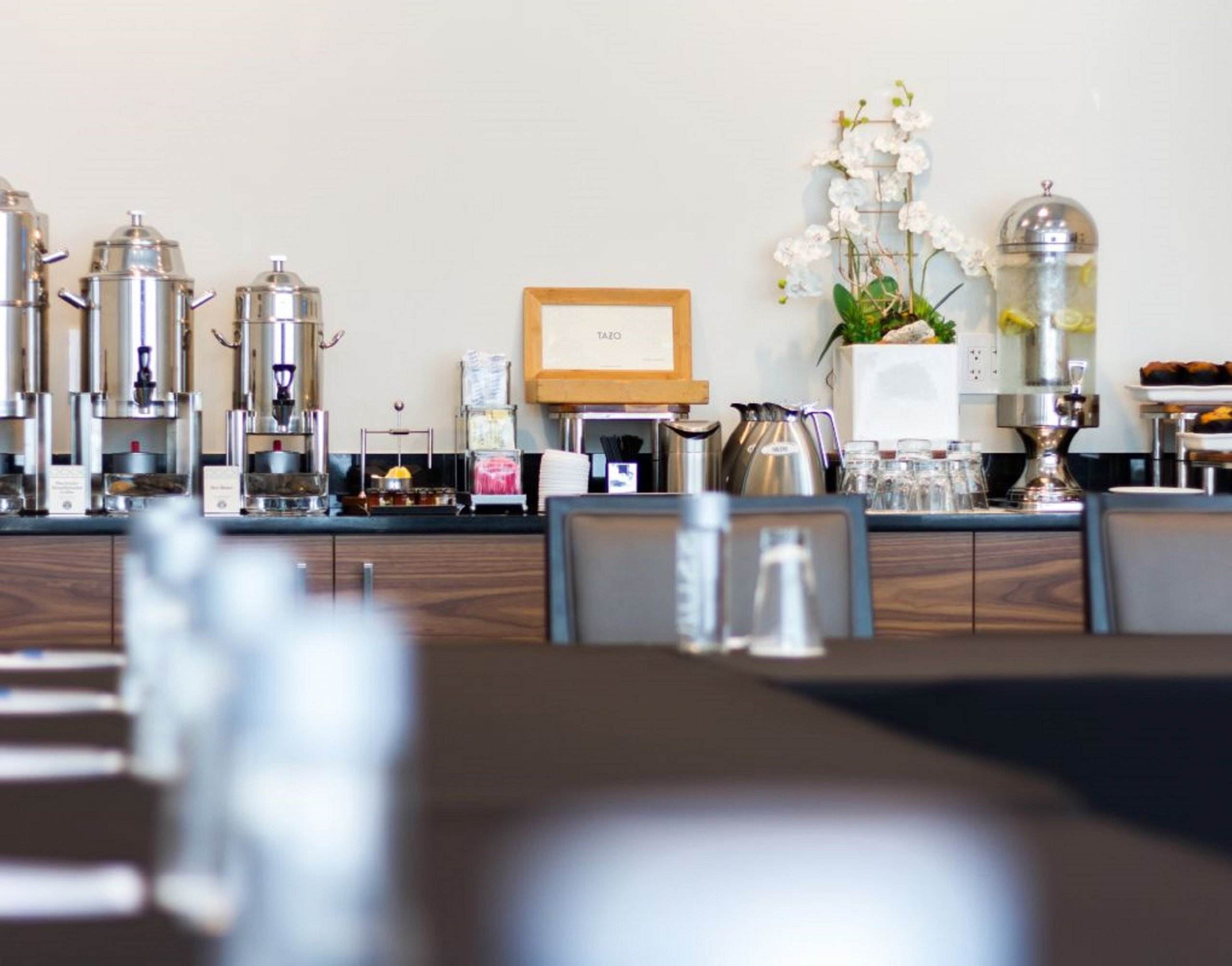 Table next to the wooden counter with coffee dispensers