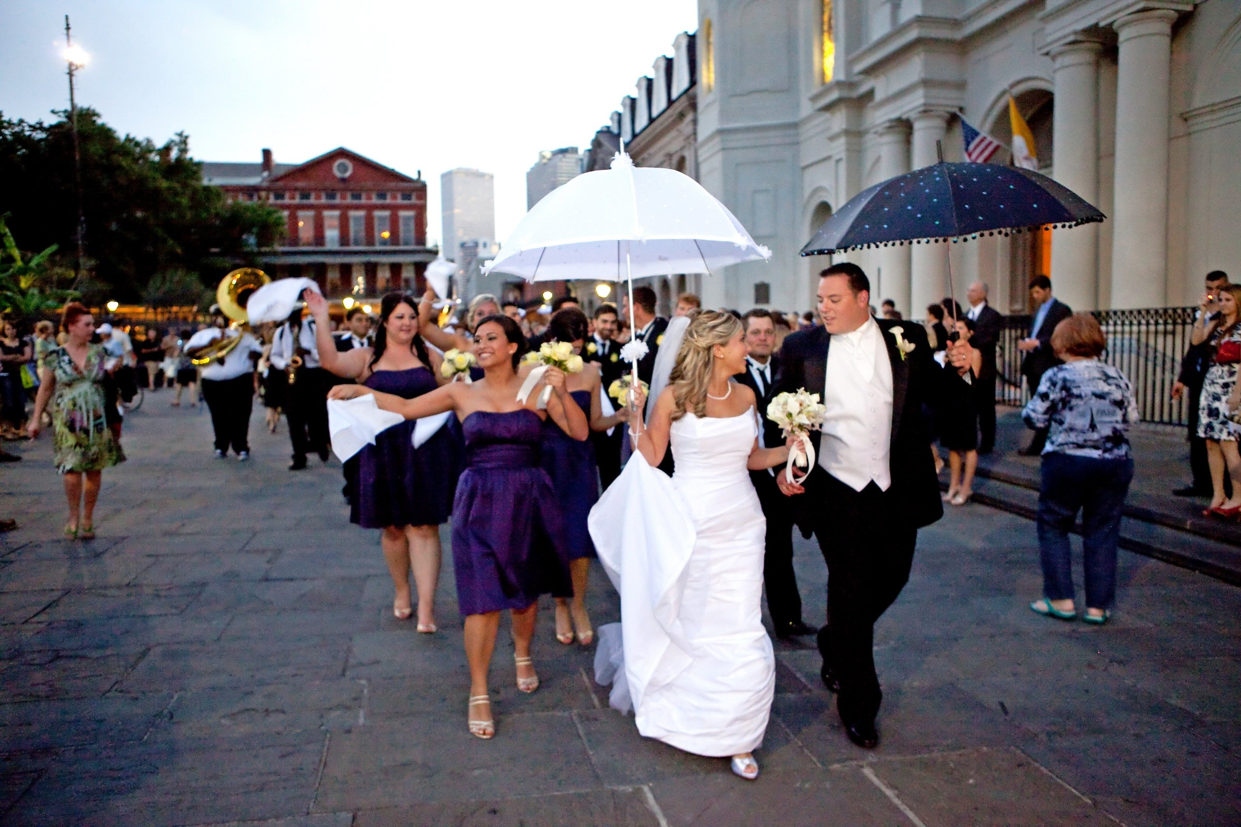 A bride and groom leading a second line in New Orleans