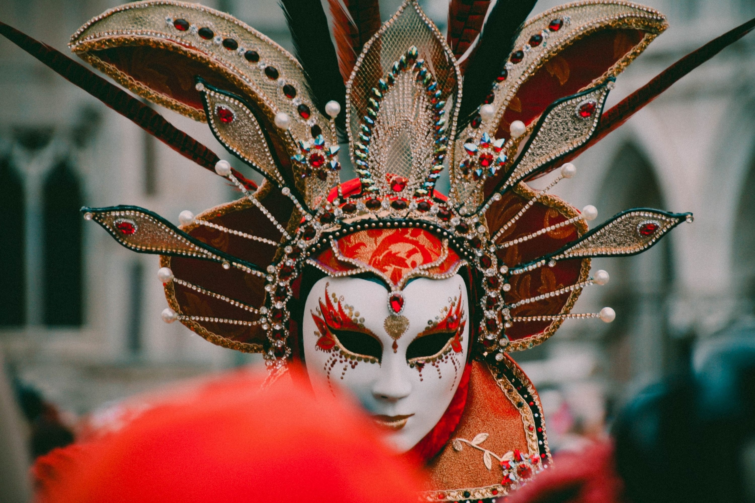 Close up of a masked woman in Mardi Gras attire