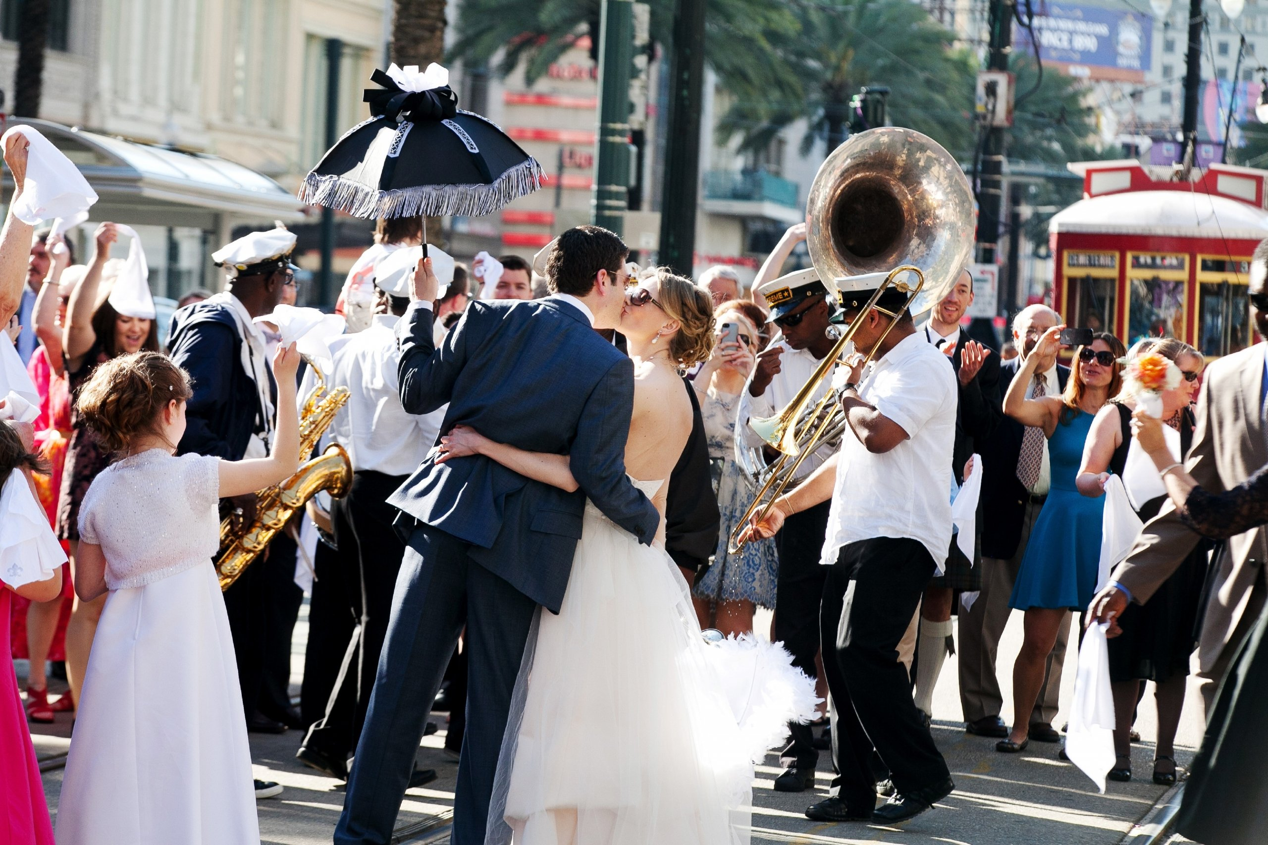 A bride and groom kissing on a New Orleans street