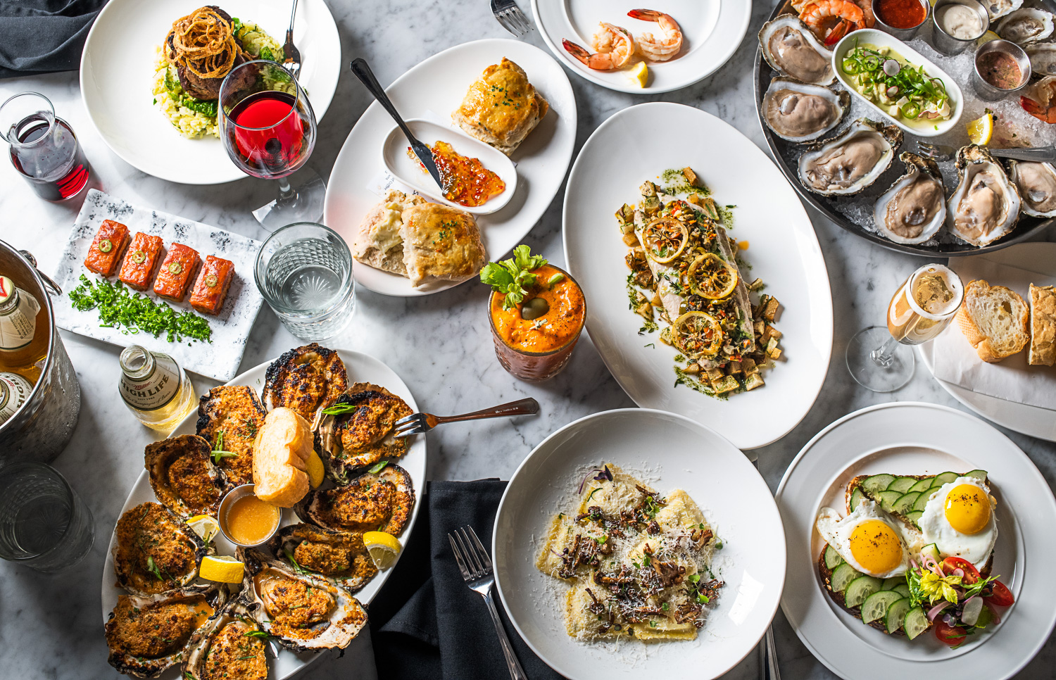 A variety of colorful and delicious looking dishes on a table
