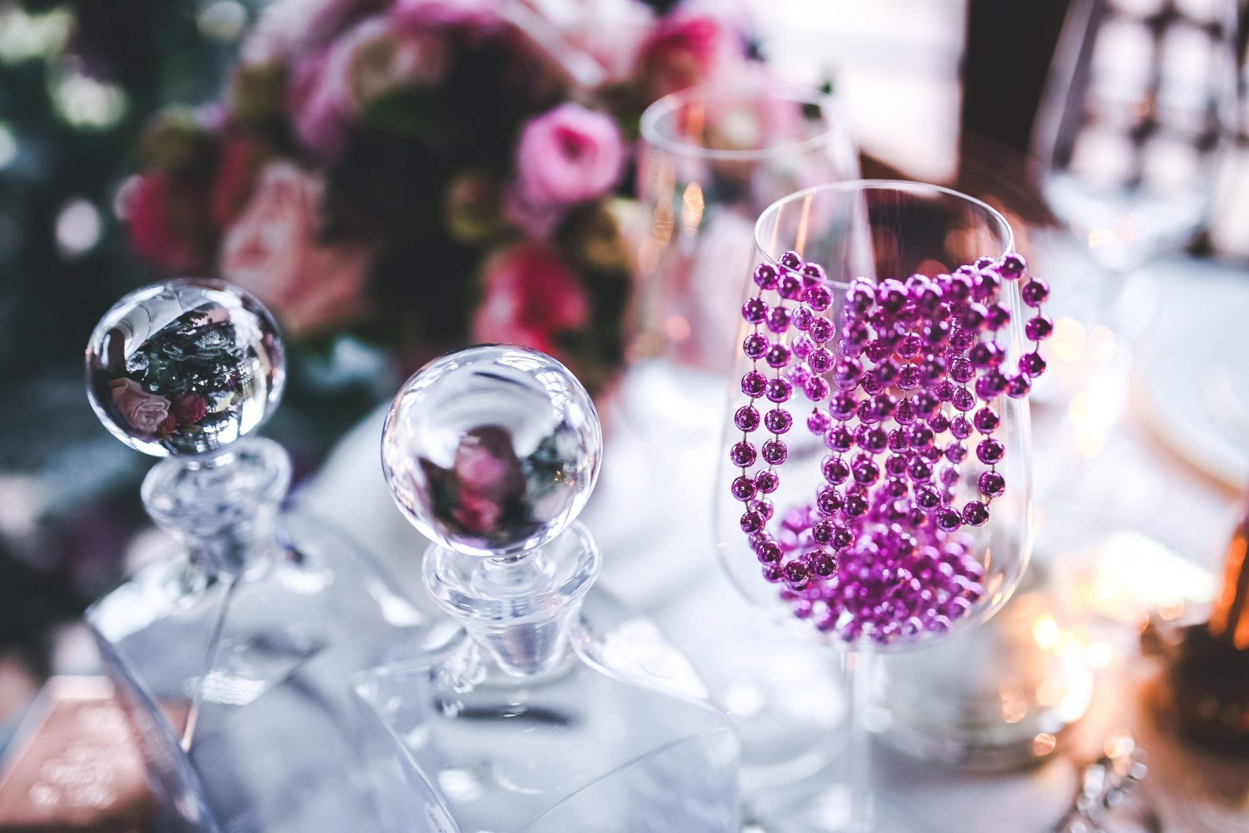 Mardi gras beads in an empty wine glass